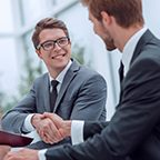 close up. young businessman and lawyer shaking hands. concept of cooperation